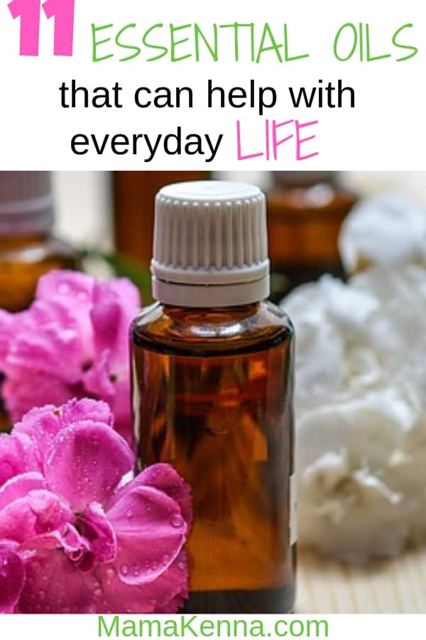 Pinterest 11 essential oils that can help with everyday life. Essential oil bottles with pink and white flowers.